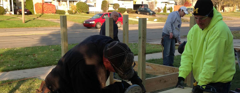 DeMaria teams with Engineers without Borders to build a wheelchair ramp for a disable veteran.